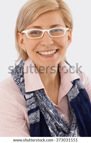 Closeup portrait of happy businesswoman with white glasses.