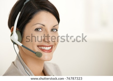 Closeup portrait of happy customer service operator talking on headset.? - stock photo