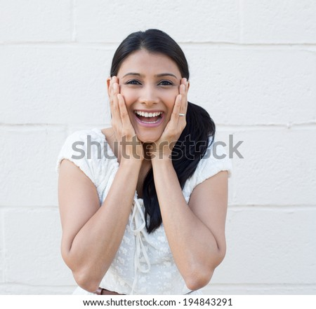 Closeup portrait of happy cute young beautiful woman looking shocked surprised in disbelief hands on face isolated white brick background. Positive human emotion, facial expression, feeling, reaction - stock photo