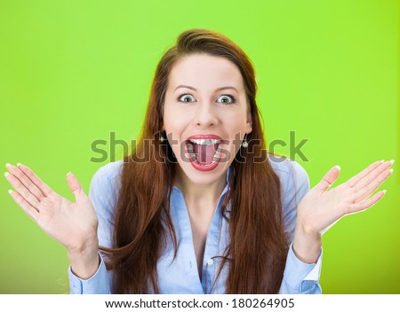 Closeup portrait of happy cute young beautiful woman looking shocked surprised in full disbelief hands in air isolated on green background. Positive human emotion, facial expression, feeling, reaction - stock photo
