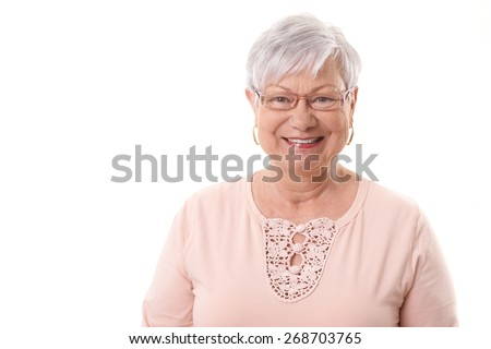 Closeup portrait of happy elderly granny, smiling, looking at camera. - stock photo