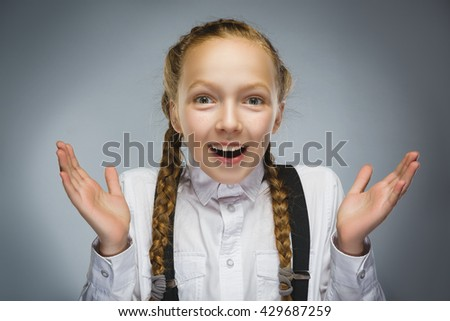 Closeup Portrait of happy girl going surprise isolated on gray background - stock photo