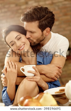Closeup portrait of happy kissing couple embracing in the morning. - stock photo