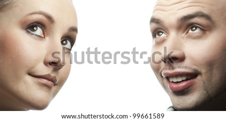 Closeup portrait of happy man and woman looking up - stock photo