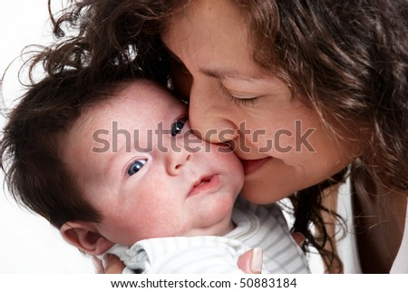 closeup portrait of happy mother with baby
