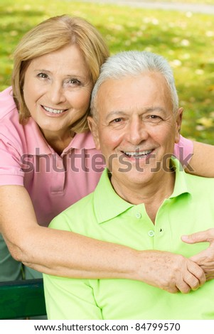 Closeup portrait of happy old people outdoors. - stock photo