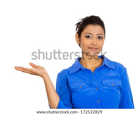 Closeup portrait of happy pretty confident young smiling woman gesturing to space at left with palm up isolated on white background. Positive human emotion signs symbol, facial expression feelings - stock photo