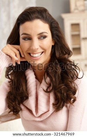 Closeup portrait of happy smiling young attractive woman, looking away. - stock photo