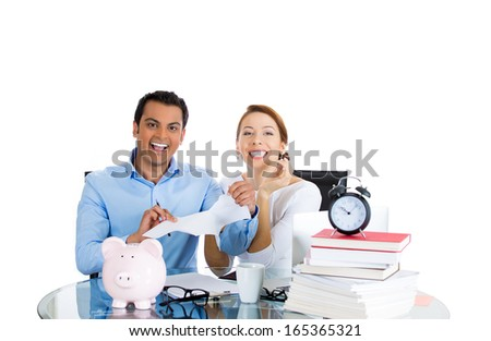 Closeup portrait of happy, successful smiling couple man woman celebrating financial success, tearing apart last statement bill, isolated on white background. Positive human emotion, facial expression - stock photo