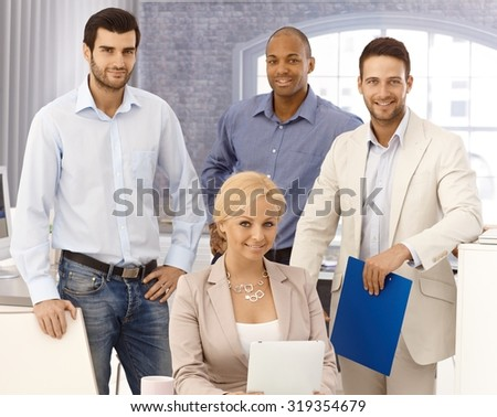 Closeup portrait of happy young businessteam smiling, looking at camera. - stock photo