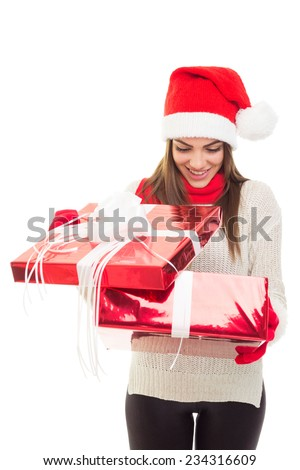 Closeup portrait of happy young Caucasian brunette woman opening Christmas gift box smiling. No retouch, vertical image. - stock photo