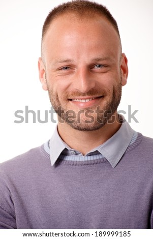 Closeup portrait of happy young man looking at camera. - stock photo