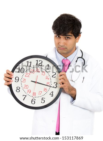 Closeup portrait of healthcare professional or doctor or nurse holding up big clock, isolated on white background - stock photo