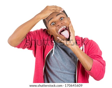 Closeup portrait of hysterical mad man going nuts sticking tongue out, pulling mouth and being confused funny faces, isolated on white background. Negative human emotion facial expressions feeling
