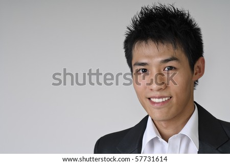 Closeup portrait of immature young business man of Asian. - stock photo