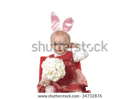 Closeup portrait of little girl with hare ears sitting on the chair - stock photo