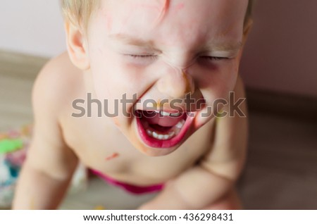 Closeup portrait of little screaming girl. Photo at home. - stock photo