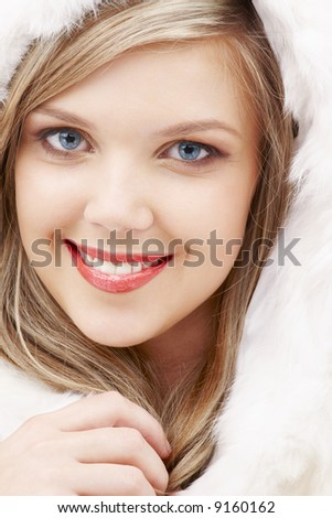 closeup portrait of lovely blond in fur - stock photo