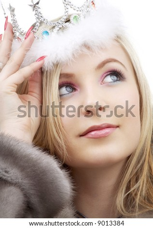 closeup portrait of lovely blond in fur and crown - stock photo