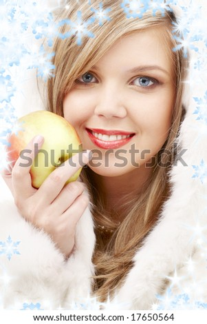 closeup portrait of lovely blond in fur with apple - stock photo