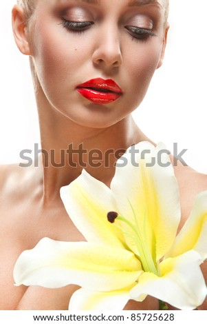 closeup portrait of lovely young woman with yellow lily over white background - stock photo