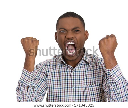 Closeup portrait of mad angry pissed off irritated young guy, fists clenched raised open mouth, screaming, shouting, yelling isolated on white background. Negative emotion facial expression feeling - stock photo