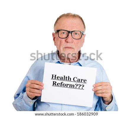 Closeup portrait of mad nerd, senior mature, skeptical man holding a sign health care reform, hoping for universal health care coverage, isolated white background. politics, government ,legislation - stock photo