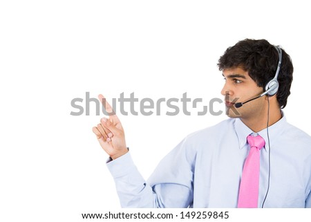 Closeup portrait of male customer service representative or call centre worker or operator or support staff pointing, isolated on white background with copy space - stock photo