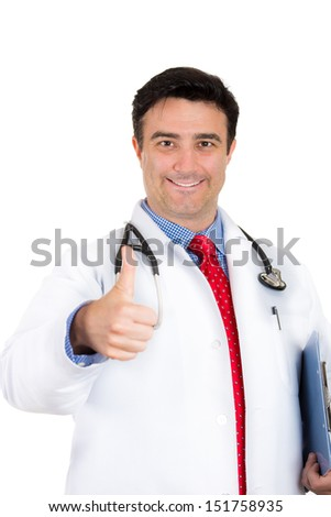 Closeup portrait of male doctor or healthcare professional or nurse wearing red tie and stethoscope giving a thumbs up sign, isolated on white background with copy space - stock photo