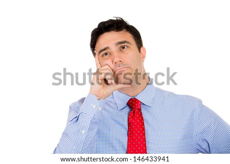 Closeup portrait of man in deep thought with chin resting on hand and looking up, isolated on white background with copy space