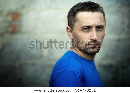 Closeup portrait of man's face - stock photo