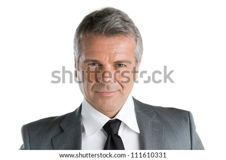 Closeup portrait of mature businessman looking at camera with satisfaction, isolated on white background - stock photo