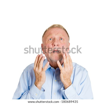 Closeup portrait of mature man praying, imploring, hands in air, hoping for best, asking forgiveness, miracle isolated white background. Positive human emotion facial expression feelings, reaction - stock photo