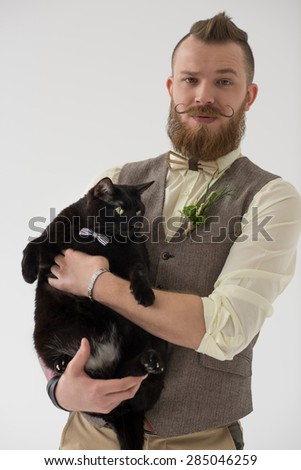 Closeup portrait of modern groom and his cat both wearing bow tie - stock photo