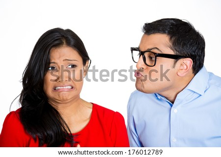 Closeup portrait of nerdy young man with big black glasses trying to kiss snobby woman who is grossed out, disgusted funny smirk on face, isolated white background. Negative emotion facial expression - stock photo