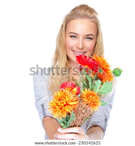 Closeup portrait of nice girl with floral bouquet isolated on white background, beautiful autumn flowers, Thanksgiving day, holiday celebration concept - stock photo