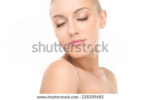 closeup portrait of nude young beautiful woman isolated on white. portrait of beautiful face with beautiful closed eyes - stock photo