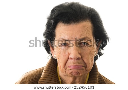 closeup portrait of old cranky grumpy sad woman grandmother - stock photo