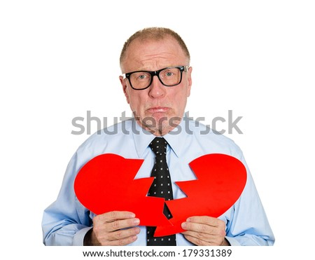 Closeup portrait of old man, sad senior executive, businessman, corporate employee, mature guy, holding broken heart in his hands, about to cry isolated on white background. Human emotion, expressions - stock photo