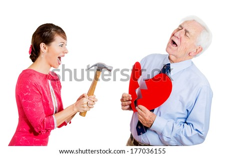 Closeup portrait of old man, senior executive, businessman, corporate employee, mature guy, having heart broken by young woman with hammer, isolated on white background. Human emotions, expressions. - stock photo