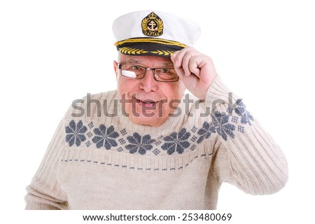 Closeup portrait of old senior man with a boat captain cap. Isolated - stock photo