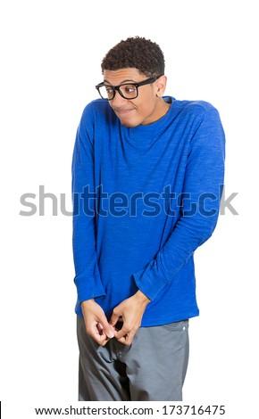 Closeup portrait of one young, quiet, nerdy, geek looking man with glasses, very nervous, timid, shy, coy, anxious, socially awkward, isolated on white background. Human emotions, facial expressions - stock photo