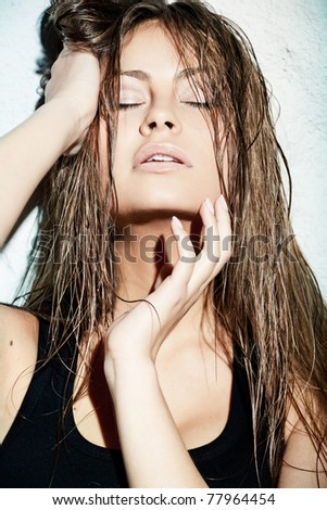 Closeup portrait of passionate woman with wet hair - stock photo