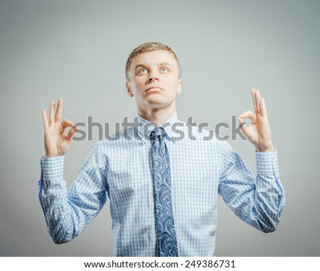 Closeup portrait of peaceful serene young man meditating in zen mode om position looking upward, isolated on white background. Positive human emotion facial expression - stock photo