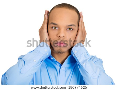 Closeup portrait of peaceful, tranquil, looking relaxed, young corporate business man covering his ears, observing, isolated white background. Hear no evil concept. Human emotions, facial expressions - stock photo