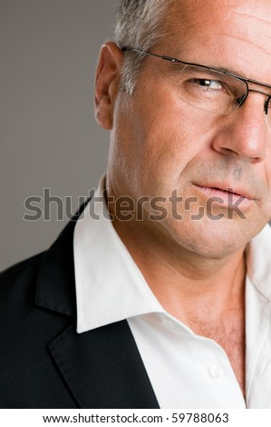 Closeup portrait of pensive mature man with glasses - stock photo