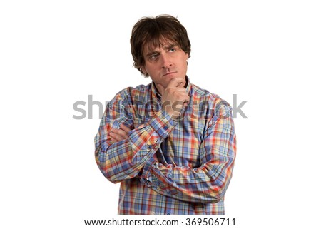 Closeup portrait of pensive young man in checkered shirt. Isolated on white background. - stock photo