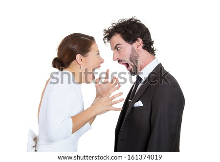 Closeup portrait of people, man and woman, couple screaming at each other, blaming each other for problem, isolated on white background. Marriage difficulties concept, negative emotions, expressions - stock photo