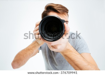 Closeup portrait of photographer making shot on photo camera - stock photo