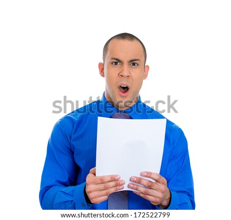 Closeup portrait of pissed off young man looking shocked and disgusted at his monthly statement, isolated on white background. Negative emotion facial expression feelings. Financial crisis, bad news - stock photo